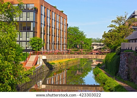 Canal along the north bank of the Potomac River at Georgetown, Washington DC. Bridges along the canal in a spring morning. - stock photo