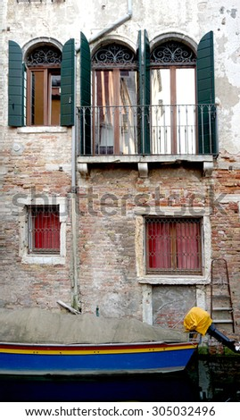 canal and boats with ancient architecture in Venice, Italy - stock photo