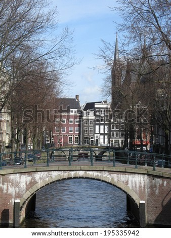 Canal and bridge in Amsterdam, capital of Holland - stock photo