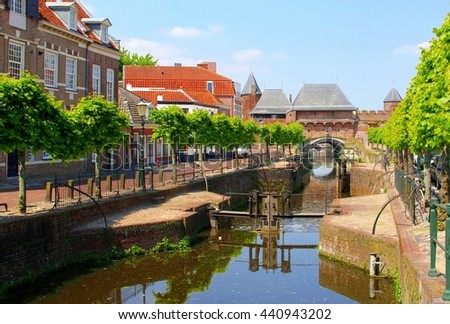 Canal and medieval Koppelpoort gate in the old fortress city of Amersfoort, Netherlands  - stock photo