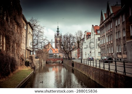 canal and old historic buildings in the old town of Gdansk, Poland - stock photo