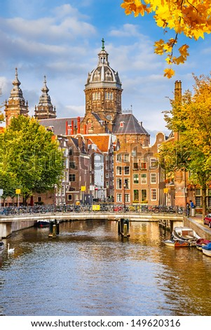 Canal and St. Nicolas Church in Amsterdam, the Netherlands - stock photo