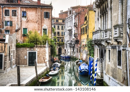 Canal, boats and buildings in Venice, Italy - stock photo
