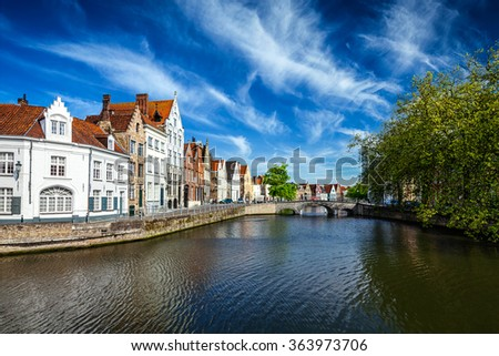 Canal, bridge and row of old houses, Bruges (Brugge), Belgium - stock photo