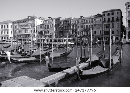 Canal Grande and gondolas - passenger transportation boats typical for Venice, Italy. Black and white tone - retro monochrome color style. - stock photo