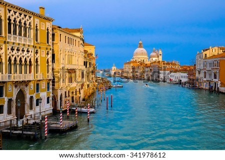 Canal Grande with Basilica di Santa Maria della Salute in golden evening light at sunset in Venice, Italy - stock photo