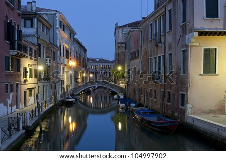 Canal in Venice, Italy at night. - stock photo