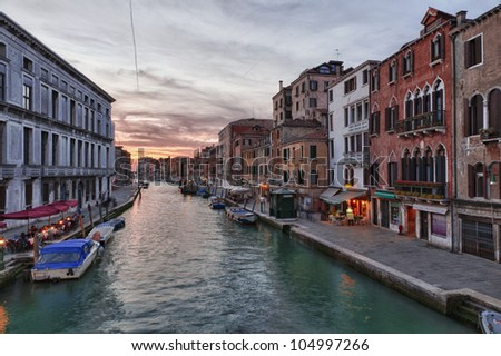 Canal in Venice, Italy at sunset. - stock photo
