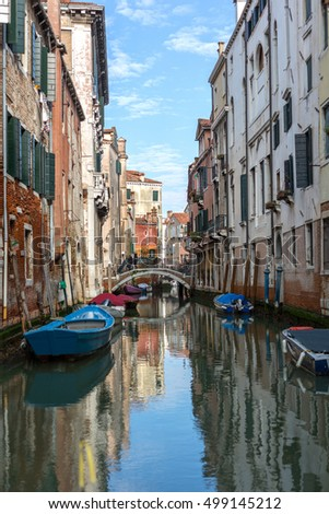 Canal in Venice  With Boats and Colorful Facades of Old Medieval Houses -Italy
