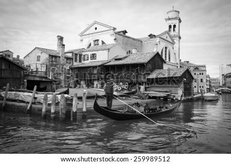 Canal Rio de San Trovaso, gondola construction and repairs yard, Squero di San Trovaso and San Trovaso church, Venice Italy. - stock photo