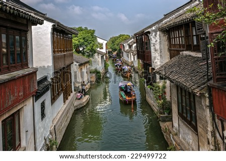 Canal scene in the old water township of Zhouzhuang, China - stock photo
