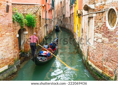 Canal with gondola in Venice, Italy - stock photo