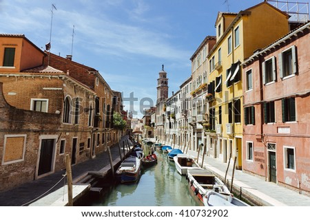 Canal with gondolas scene, Venice, Italy.  Venice canal view with parked boats and colorful buildings. Venice city scene. Beautiful Venice cityscape. Famous Venice scene. Colorful Venice.  Venice view - stock photo