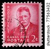 CANAL ZONE, PANAMA - CIRCA 1975: A 2-cent stamp printed in the Canal Zone, Isthmus of Panama, shows Theodore Roosevelt, circa 1975 - stock photo