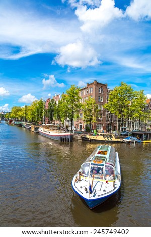 Canals of Amsterdam. Amsterdam is the capital and most populous city of the Netherlands - stock photo