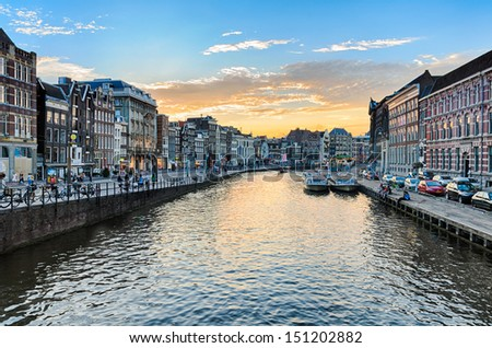 Canals of Amsterdam at sunset, Netherlands - stock photo