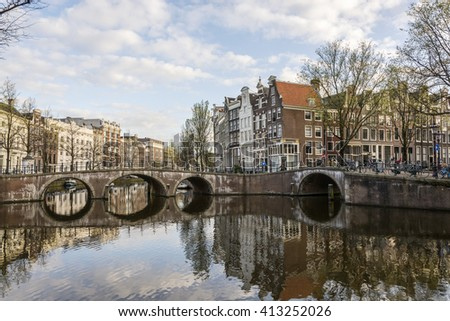 Canals of Amsterdam. Traditional old dutch houses on the bridge in spring. Amsterdam, Netherlands