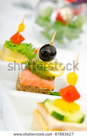Canape served in the plate - stock photo