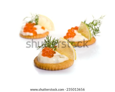 Canape with Caviar on white background - stock photo