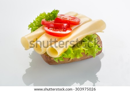 canape with yellow cheese - stock photo