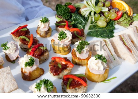 Canapes and fruit - stock photo