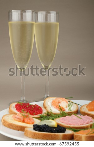 canapes and glasses of champagne - stock photo