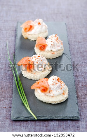 Canapes chiffon smoke trout and crab - stock photo