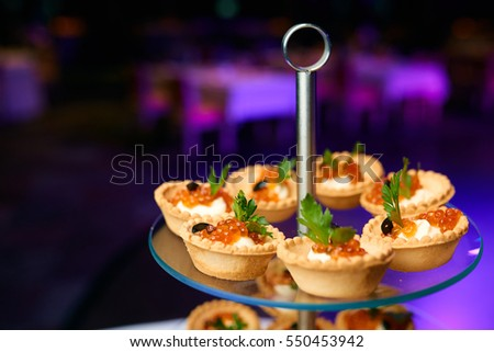 Canapes caviar on table restaurant stock photo 550453942 for Canape restaurant