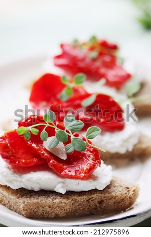 Canapes of cheese sundried tomato and thyme - stock photo