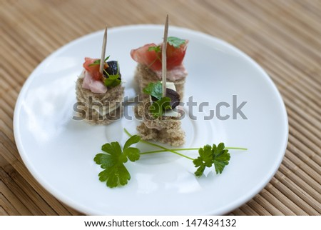 Canapes on a white plate
