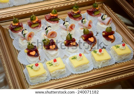 Canapes on party table - stock photo