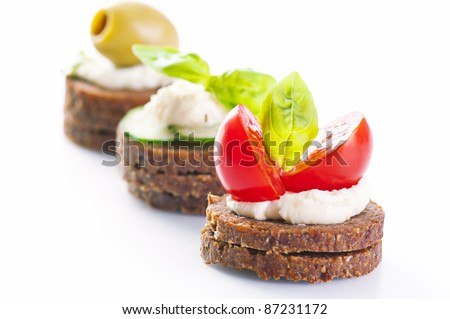 canapes with cheese and venetables - stock photo