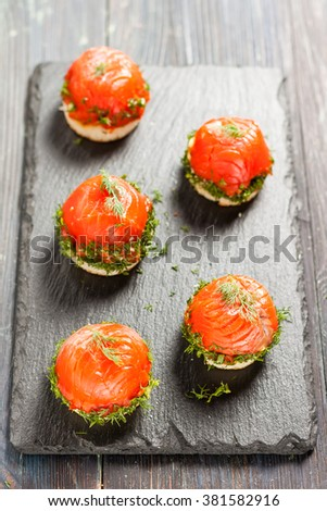 canapes with salmon and curd cheese - stock photo