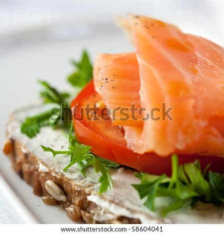 Canapes with smoked salmon - stock photo