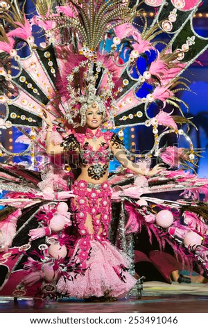 CANARY ISLAND, SPAIN - FEBRUARY 13, 2015: Begona Padron Foncubierta onstage with costume from designer Miguel Cruz during city of Las Palmas carnival One Thousand and One Nights Queens Gala show. - stock photo