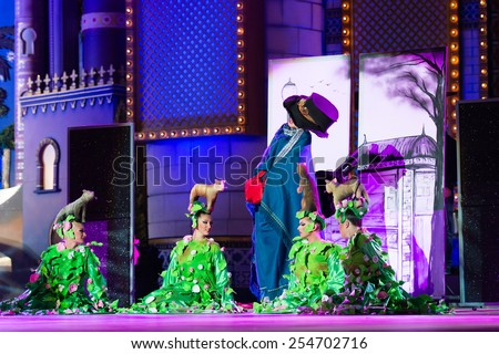 CANARY ISLAND, SPAIN - FEBRUARY 20, 2015: Drag Acrux (m) as old woman and unidentified assistants performing onstage during city of Las Palmas carnival Drag Queen Gala. - stock photo