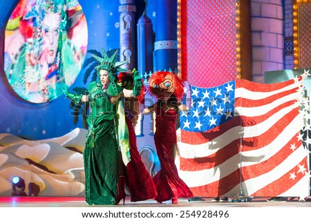 CANARY ISLAND, SPAIN - FEBRUARY 20, 2015: Drag Dafne del Giogio (l) as Statue of Liberty and unidentified assistants with comic costumes performing onstage during Las Palmas carnival Drag Queen Gala. - stock photo