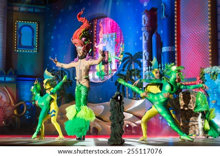 CANARY ISLAND, SPAIN - FEBRUARY 20, 2015: Drag Eiko as mermaid with costume from Jorge Perez and unidentified colorful assistants performing onstage during city of Las Palmas carnival Drag Queen Gala. - stock photo