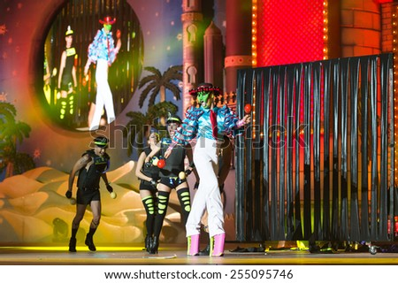 CANARY ISLAND, SPAIN - FEBRUARY 20, 2015: Drag Gio with Mexican costume from designer Raico Santana unidentified assistants as policemen onstage during Las Palmas carnival Drag Queen Gala. - stock photo
