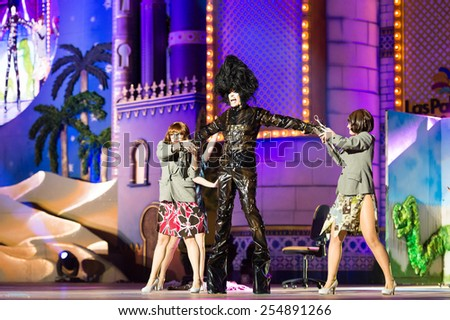 CANARY ISLAND, SPAIN - FEBRUARY 20, 2015: Drag Mulciber (m) as Edward Scissorhands and unidentified assistants with secretary costumes performing onstage during Las Palmas carnival Drag Queen Gala. - stock photo