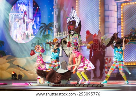 CANARY ISLAND, SPAIN - FEBRUARY 20, 2015: Drag Vulcano with costume from designer Isidro Javier Perez Mateo and unidentified assistants performing onstage during  Las Palmas carnival Drag Queen Gala. - stock photo