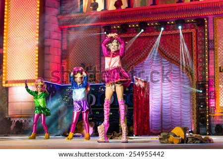 CANARY ISLAND, SPAIN - FEBRUARY 20, 2015: Drag Ziben (r) with costume from designer Jonay Espino and unidentified women onstage during city of Las Palmas carnival Drag Queen Gala - stock photo