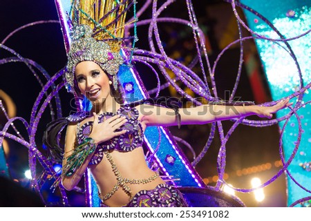 CANARY ISLAND, SPAIN - FEBRUARY 13, 2015: Lola Rodriguez Diaz onstage with costume from designer Isacc Martinez Vicente during city of Las Palmas carnival One Thousand and One Nights Queens Gala show. - stock photo