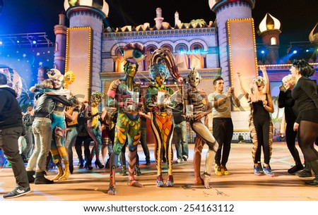 CANARY ISLAND, SPAIN - FEBRUARY 17, 2015: The winners are Idaira Bujeda Molina (m), Anyelo Perez (r) and Nadine Ruegg (l) in the city of Las Palmas carnival Body Painting Contest. - stock photo