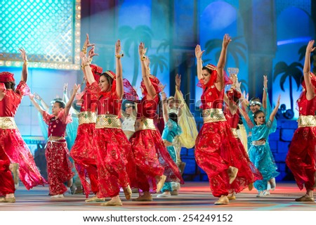 CANARY ISLAND, SPAIN - FEBRUARY 15, 2015: Unidentified children with red Arabic costumes dancing onstage during city of Las Palmas carnival One Thousand and One Nights Junior Queen Gala opening show. - stock photo
