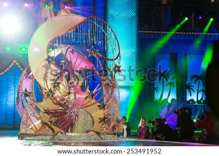 CANARY ISLAND, SPAIN - FEBRUARY 13, 2015:Virginia de Leon Curbelo onstage with costume from designer Julio Vicente Artiles during Las Palmas carnival One Thousand and One Nights Queens Gala show. - stock photo