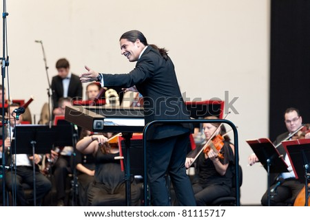 CANARY ISLANDS - JULY 16: Conductor Jose Luis Gomez-Rios born in Venezuela, performing onstage during Festival of Music July 16, 2011 in Las Palmas, Canary Islands, Spain - stock photo