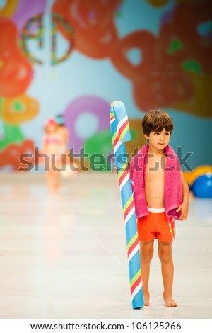 CANARY ISLANDS -JUNE 22: An unidentified model walks the runway in Alida Dominguez Baby collection during Gran Canaria Moda Calida swimwear fashion show on June 22, 2012 in Canary Islands, Spain - stock photo