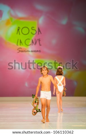 CANARY ISLANDS -JUNE 22: Unidentified models walks the runway in Rosa La Cave collection during Gran Canaria Moda Calida swimwear fashion show on June 22, 2012 in Canary Islands, Spain - stock photo