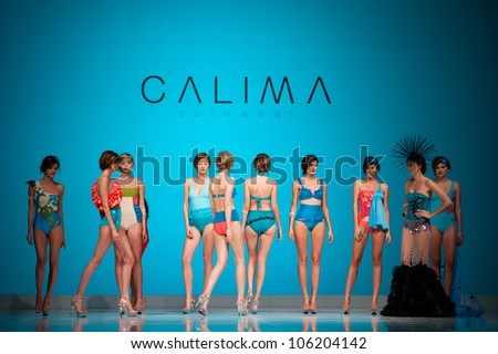 CANARY ISLANDS -JUNE 22: Unidentified models walks the runway in the Calima collection during Gran Canaria Moda Calida swimwear fashion show on June 22, 2012 in Canary Islands, Spain - stock photo